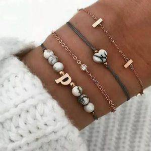 Jewelry - NWT BUY 2 GET 1 FREE SET OF 4 INDIE BRACELETS